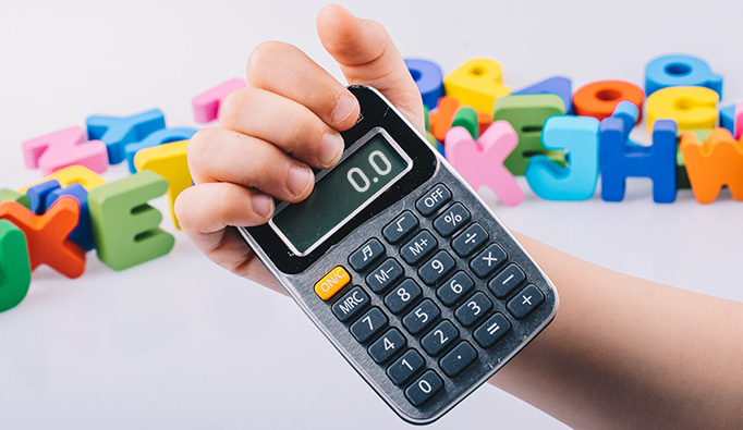 child holding calculator