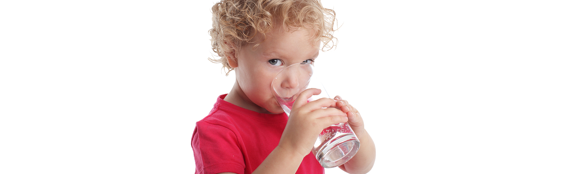 young boy drinking tap water