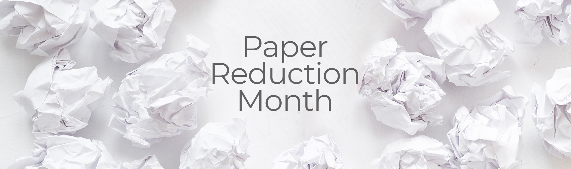 Balls of crumpled white paper and text that states Paper Reduction Month