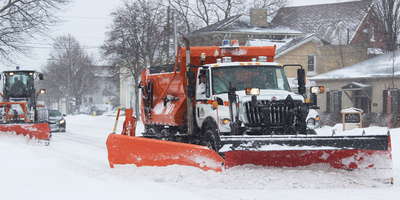 Snow removal on a snow covered street