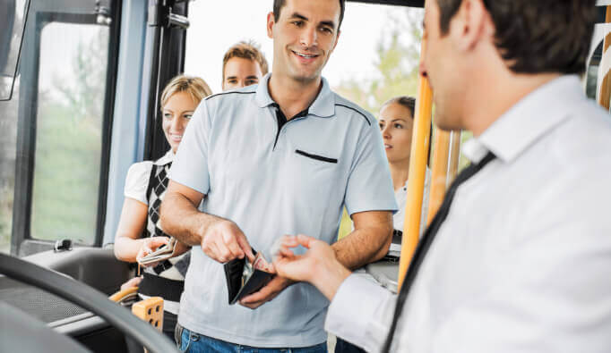 Man paying bus driver