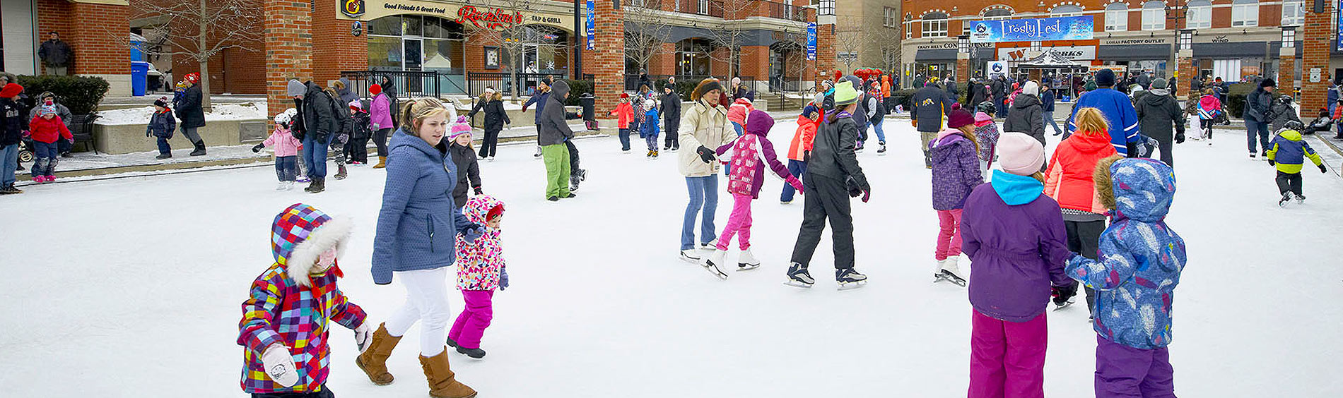 Harmony Square ice rink skaters
