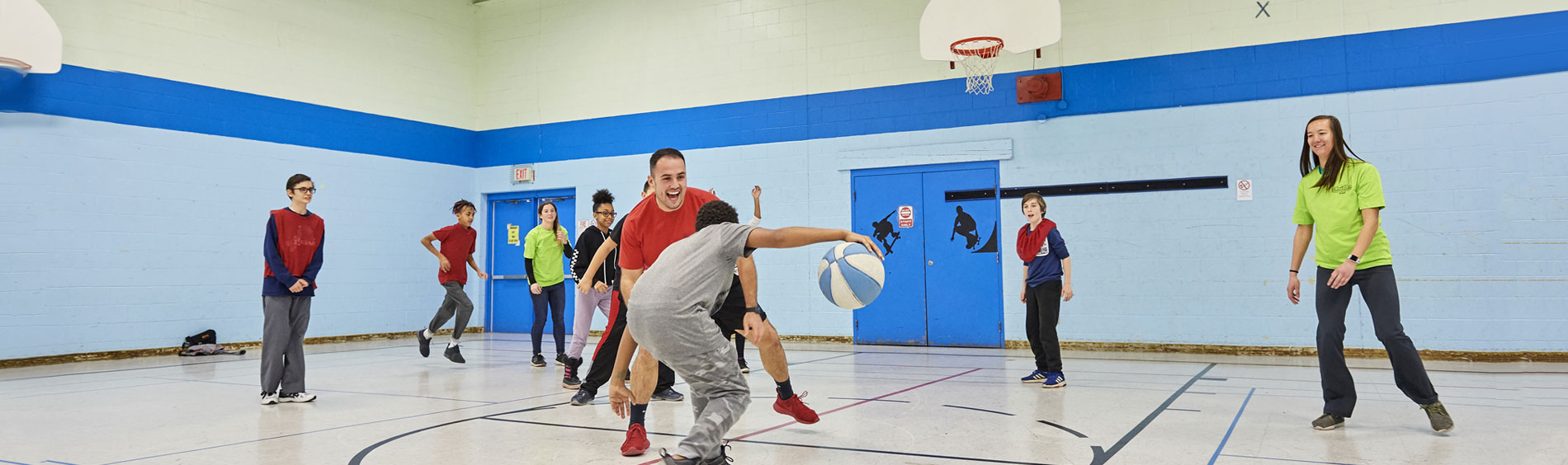 Image of playing basketball at Woodman Community Centre