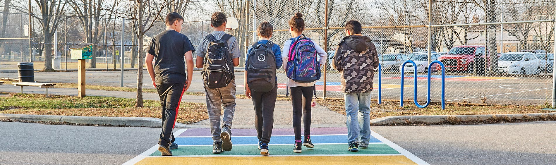 teens walking together with backpacks